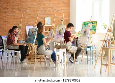 Group of people during classes in school of painters