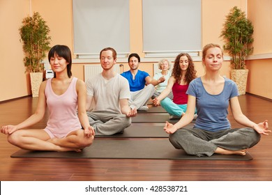 Group of people during yoga meditation breathing exercise class