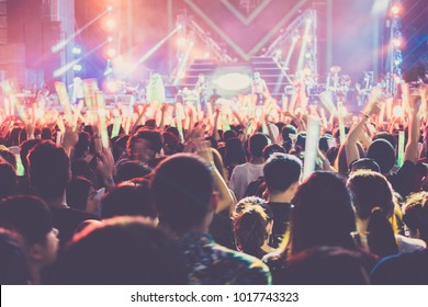 The group of people enjoying a rock concert on the night of New Year celebrations,Clapping hands.