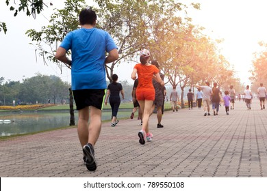 Group of people exercise walking and jogging in the park in morning