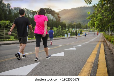 Group of people exercise walking in the park in morning. healthy concept