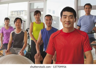 Group of people exercising in the gym, portrait