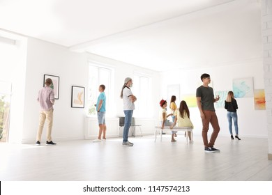 Group of people at exhibition in art gallery