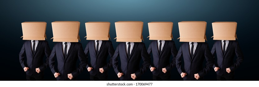 Group of people gesturing with empty box on their head
