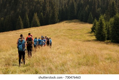 Group of people  go to mountains