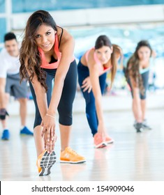 Group of people in a gym class - fitness concepts