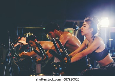 Group of people in the gym exercising legs doing cardio training