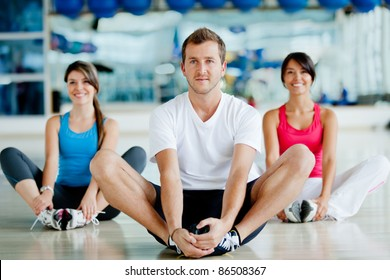 Group of people at the gym stretching