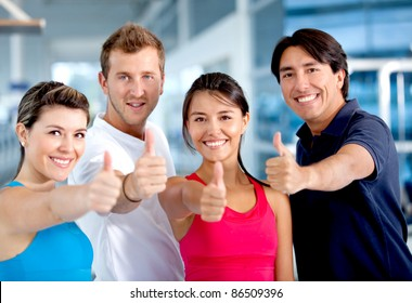 Group of people at the gym with thumbs up