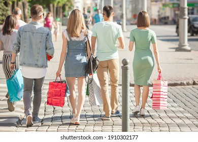 Group of people having fun and doing shopping. Friends with shopping bags.