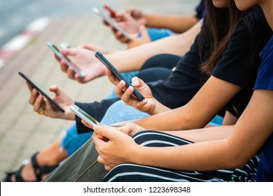 Group of people having fun with technology trends - Youth, new generation addiction and friendship concept.