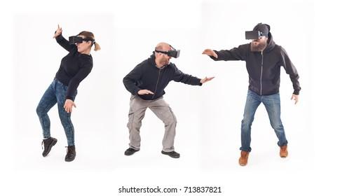 Group of people having fun with virtual reality glasses. Studio shoot