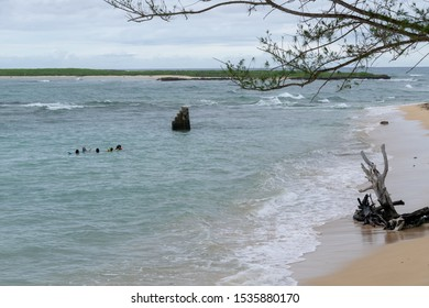A group of people having fun in the water at a secluded east side beach on Oahu, Hawaii in October