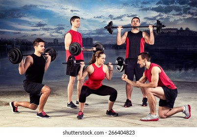 Group people having lifting training with trainer