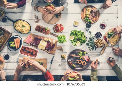 Group of people having meal together