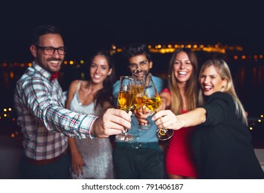 Group of people having a party, cheering with champagne