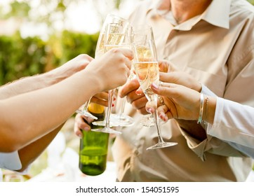 Group of people having a toast  with champagne