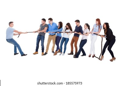 Group of people having a tug of war against one man as they pull on opposite sides of the rope conceptual of leadership  individuality  determination and challenge  on white