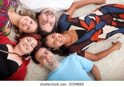 Group of people with heads together on the floor