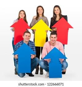 Group of people holding arrows pointing up