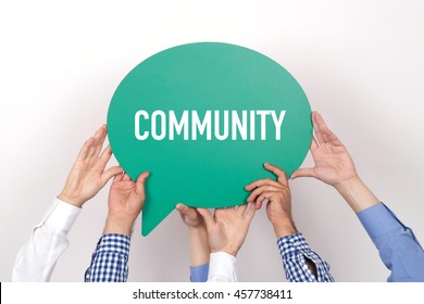 Group of people holding the COMMUNITY written speech bubble
