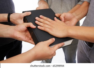 Group of people holding Holy Bible to unity, promises and prayer