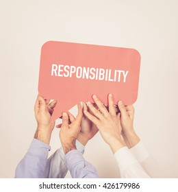 A group of people holding the Responsibility written speech bubble