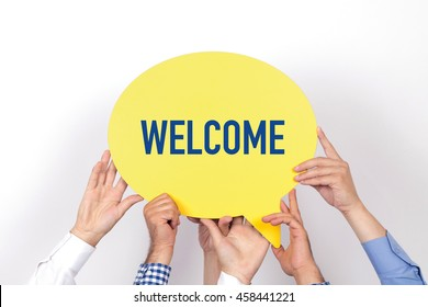 Group of people holding the WELCOME written speech bubble