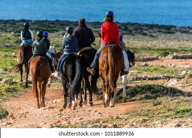 A group of people horseriding