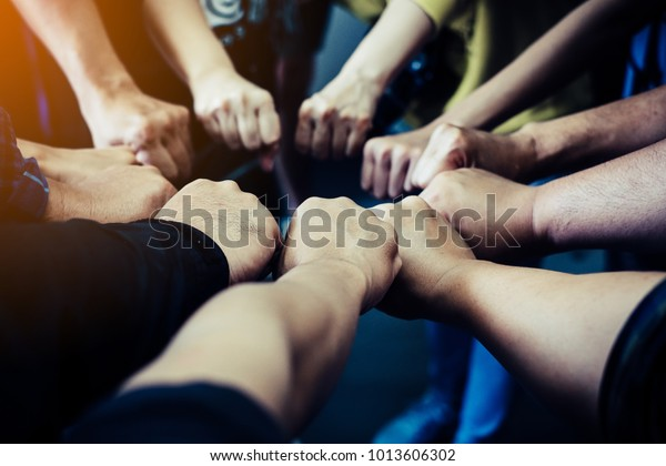 Group of people joining their hands. Teamwork concept.