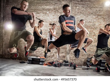 Group of people jumping and practicing cardio fitness exercise