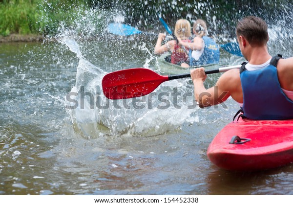 A group of people kayaking down a river