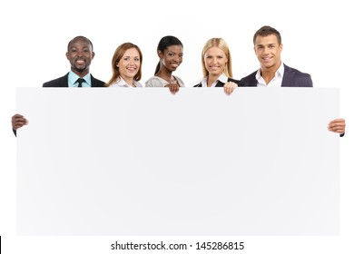 Group of people looking at camera on white background with white board