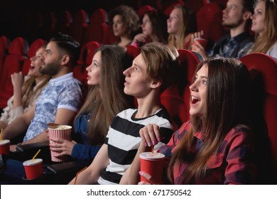 Group of people looking excited while watching a movie at the cinema audience lifestyle leisure happiness emotions shocked surprised amused concept.