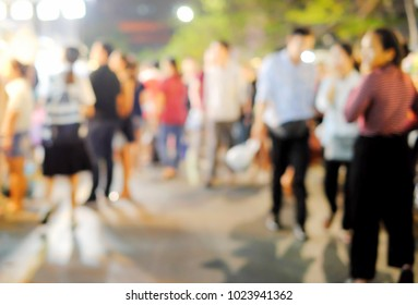 Group of people are looking for goods and service at the night market that It is free time or finish work 's them. Anything was take a picture to blur to describe abstract feelings.