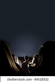 Group of people looking at the screen at the cinema