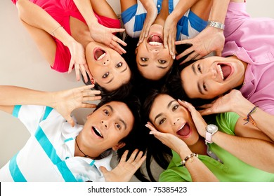 Group of people lying on the floor making surprised faces