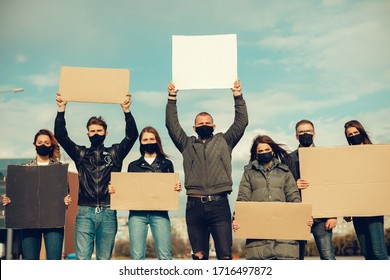 group of people with mask came out with posters to protest The population against coronavirus and against the introduction of quarantine Meeting about coronavirus and people right. copy space