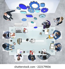 Group of People in a Meeting and Gear Symbol
