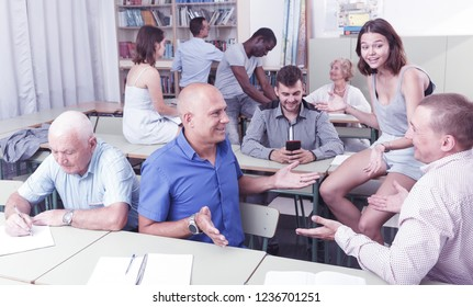 Group people mixed ages discussion during business course