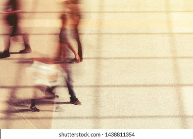 Group of people, motion blur effect. Unrecognizable commuters walking during rush hour.