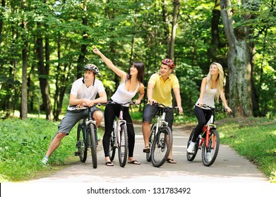 Group of people on a bicycles in a countryside