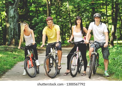 Group of people on a bicycles in green summer park