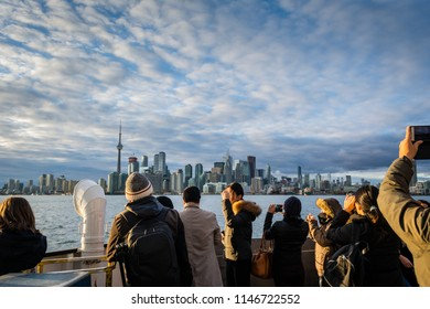 Group of people on Ferry to Toronto Islands looking at Toronto skyline
