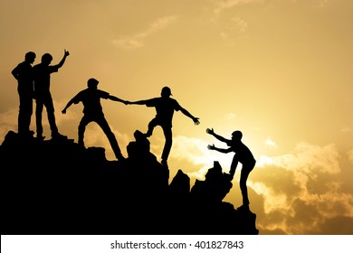 Group of people on peak mountain  climbing helping team work , success business concept