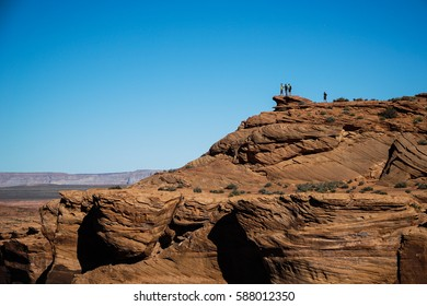 Group of people on top of a mountain