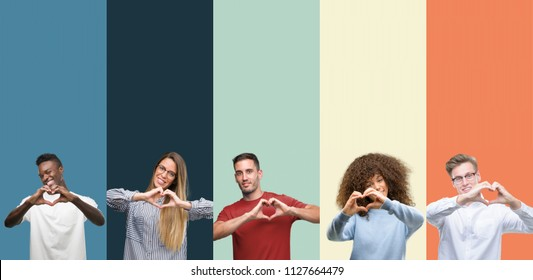 Group of people over vintage colors background smiling in love showing heart symbol and shape with hands. Romantic concept.