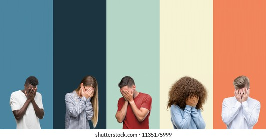 Group of people over vintage colors background with sad expression covering face with hands while crying. Depression concept.