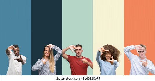 Group of people over vintage colors background smiling making frame with hands and fingers with happy face. Creativity and photography concept.