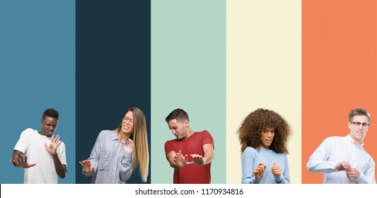 Group of people over vintage colors background disgusted expression, displeased and fearful doing disgust face because aversion reaction. With hands raised. Annoying concept.